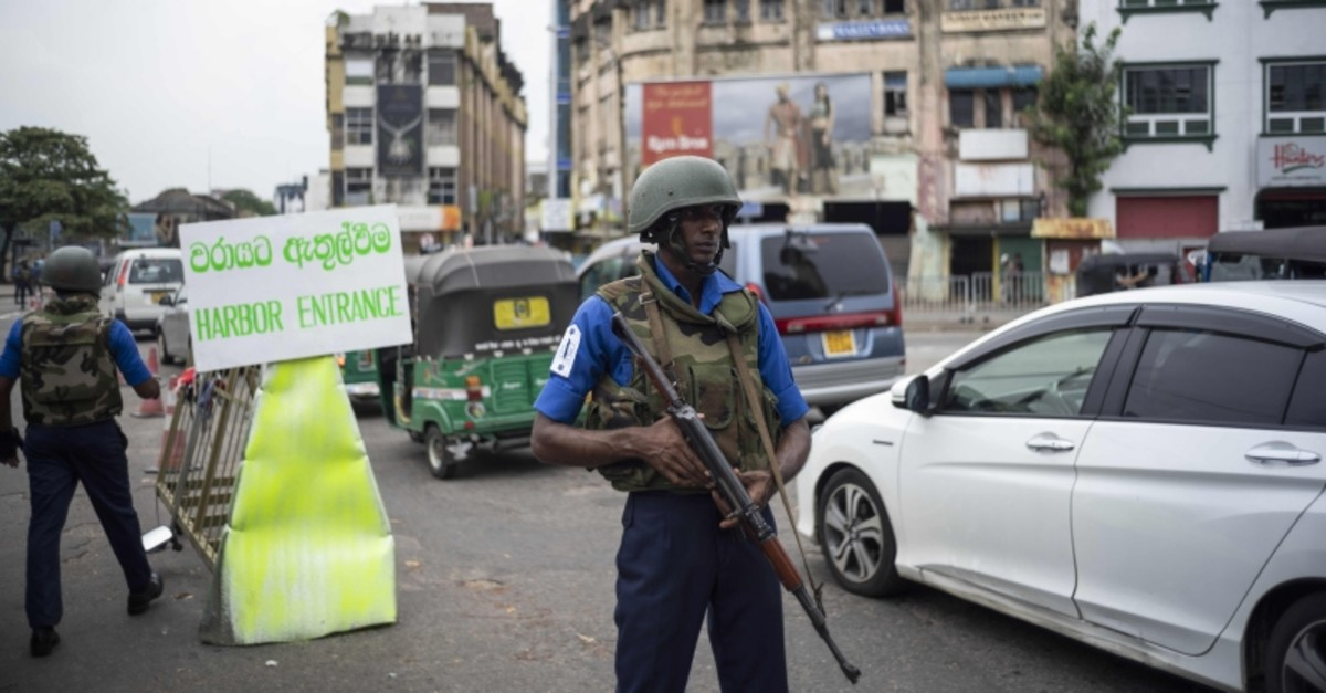 Sri Lankan soldiers man their positions at a checkpoint in Colombo. (AFP Photo)