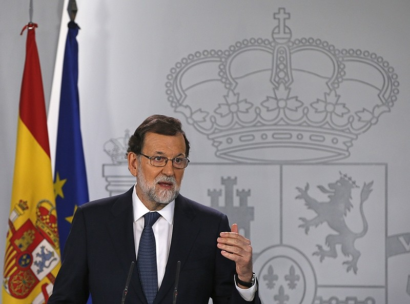 Spain's Prime Minister Mariano Rajoy gestures as he delivers a statement at the Moncloa Palace in Madrid, Spain, Oct. 11, 2017. (AP Photo)