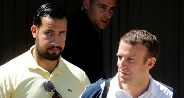 French President Emmanuel Macron, flanked by Alexandre Benalla, French presidential aide, leaves his home to play tennis in Le Touquet, France, June 17, 2017. Picture taken June 17, 2017. Reuters Photo
