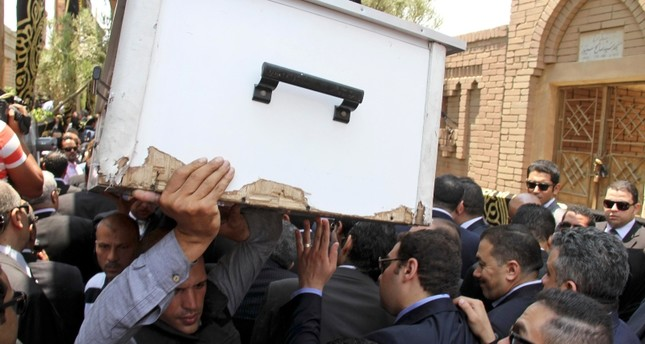 In this June 30, 2015 file photo, pall bearers carry the body of slain Egyptian Prosecutor General Hisham Barakat who was killed in bomb attack a day earlier, during his burial at a cemetery in Cairo. (AP Photo)