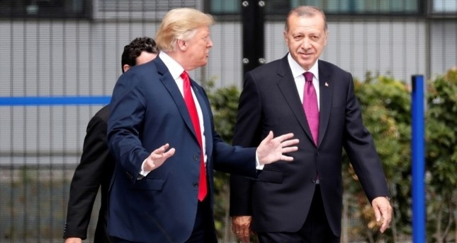 U.S. President Donald Trump, left, chats with President Recep Tayyip Erdogan as they attend for a family picture during a NATO summit in Brussels, Belgium, July 11, 2018. (EPA Photo)