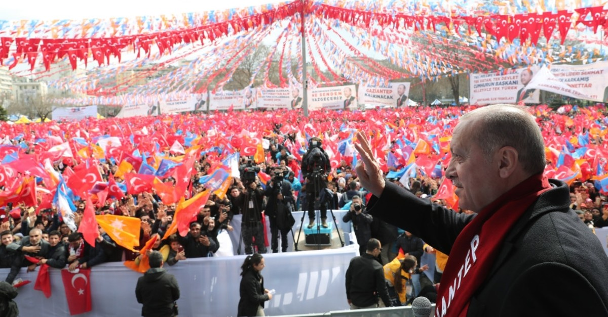 President Recep Tayyip Erdou011fan waves at the audience in southeastern Gaziantep province, March 15, 2019.