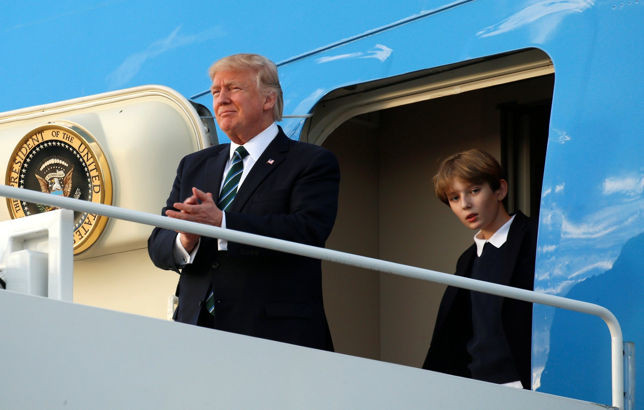 U.S. President Donald Trump and his son Barron step from Air Force One upon their arrival in West Palm Beach, Florida, U.S., March 17, 2017. (REUTERS Photo)
