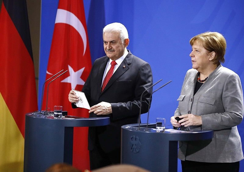 German Chancellor Angela Merkel and Turkish Prime Minister Binali Yu0131ldu0131ru0131m attend a news conference at the Chancellery in Berlin, Germany Feb.15, 2018. (Reuters Photo)
