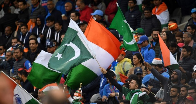 Spectators wave national flags after the 2019 Cricket World Cup group stage match between India and Pakistan at Old Trafford in Manchester, northwest England, on June 16, 2019. AFP Photo