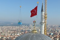 The world's biggest finial which is 7.77 meters long and has a weight of 4.5 tons was placed on Saturday on top of the dome at Istanbul's towering Çamlıca mosque.