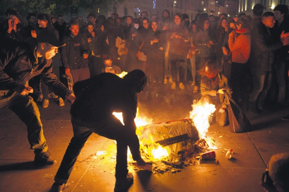 People burn litter as they protest in Paris, France, April 23.