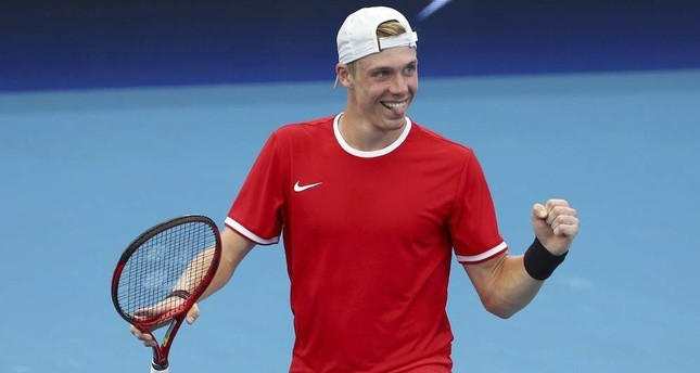 Canada's Denis Shapovalov reacts after he won his match against Stefanos Tsitsipas of Greece, Brisbane, Jan. 3, 2020. AP Photo