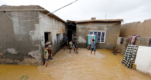 Iraq boys clean their house after heavy rainfall in al-Aziziyah, Iraq Nov. 25, 2018. (Reuters Photo)