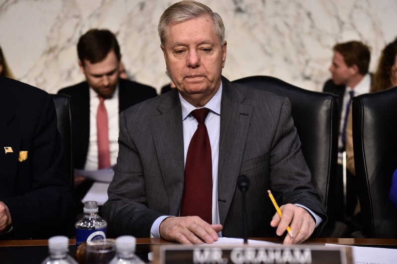 Sen. Lindsey Graham(R-SC)arrives before William Barr, nominee to be US Attorney General, testifies during a Senate Judiciary Committee confirmation hearing on Capitol Hill in Washington, DC, January 15, 2019 (AFP Photo)