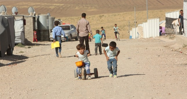 Displaced Iraqi children who fled Mosul are at a refugee camp in Duhok, Iraq, Oct. 16, 2016.