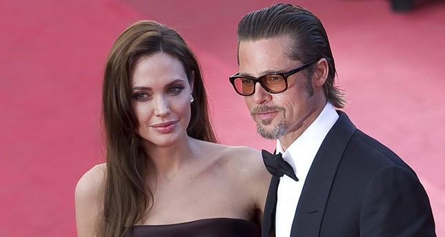 A file picture dated 16 May 2011 shows US actors Brad Pitt (R) and Angelina Jolie (L) arriving for the screening of 'The Tree of Life' during the 64th Cannes Film Festival in Cannes, France. (EPA Photo)