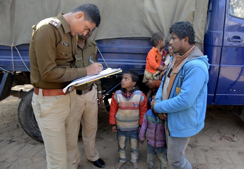Indian policeman registers names of Rohingya refugees detained while crossing the India-Bangladesh fenced border from Bangladesh, at Raimura village on the outskirts of Agatala, the capital of northeastern state of Tripura, Jan. 22, 2019. (AFP Photo)