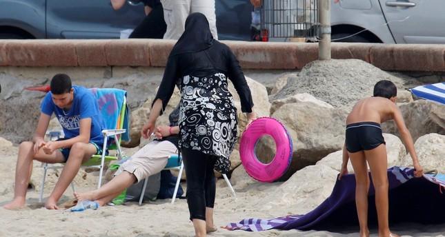 A Muslim woman wears a burkini on a beach in Marseille, France, Aug. 17