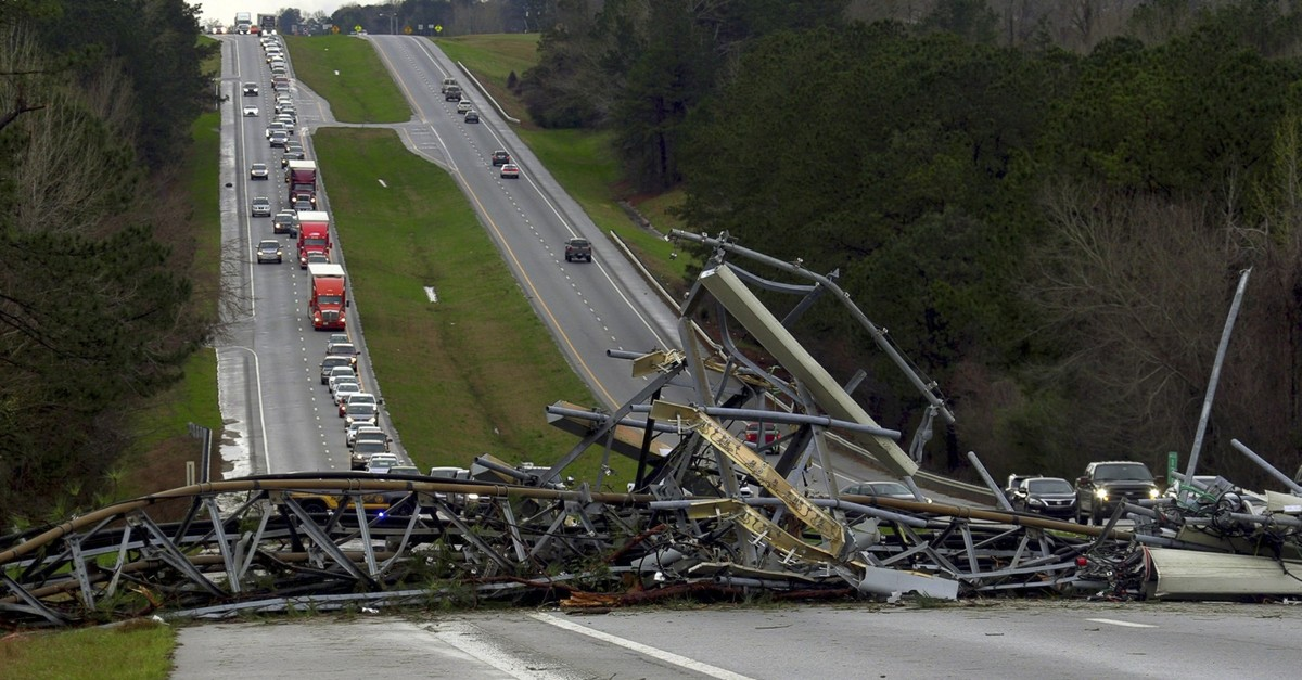 A fallen cell tower lies across U.S. Route 280 highway in Lee County, Ala., in the Smiths Station community after what appeared to be a tornado struck in the area Sunday, March 3, 2019. (AP Photo)