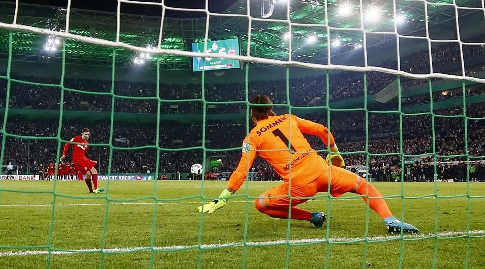 Eintracht Frankfurtu2019s Branimir Hrgota scores the winning penalty during a penalty shootout.