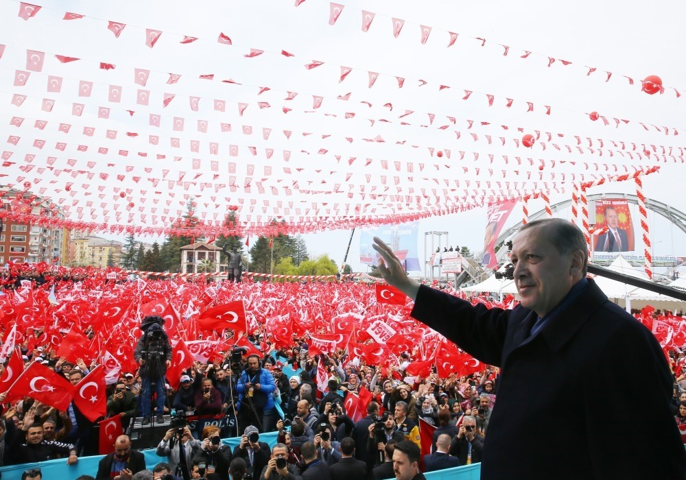 President Recep Tayyip Erdou011fan greets people in Rize during a referandum rally on April 3.