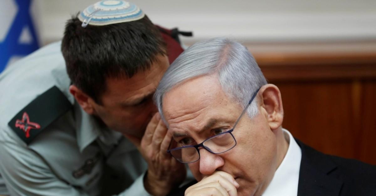 Israeli Prime Minister Benjamin Netanyahu listens to Brigadier General Avi Blot, his military secretary, during the weekly cabinet meeting in Jerusalem June 2, 2019. (Reuters Photo)