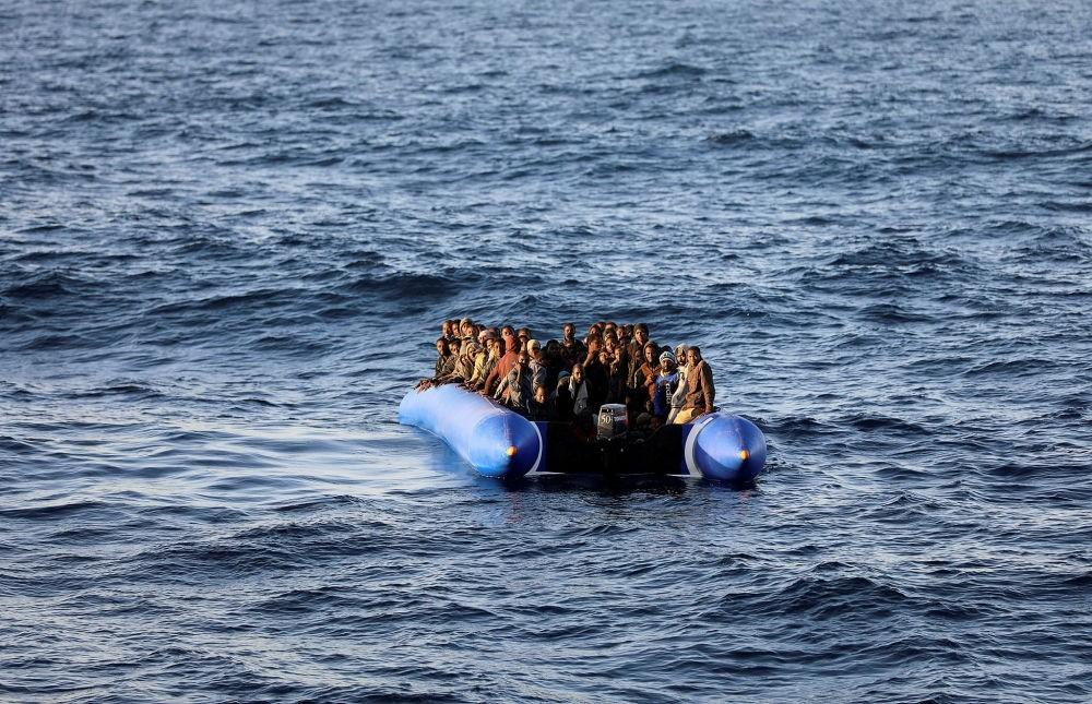 Migrants in a raft were rescued by the Libyan coast guards off the coast of Garabulli, Libya, Jan. 8.