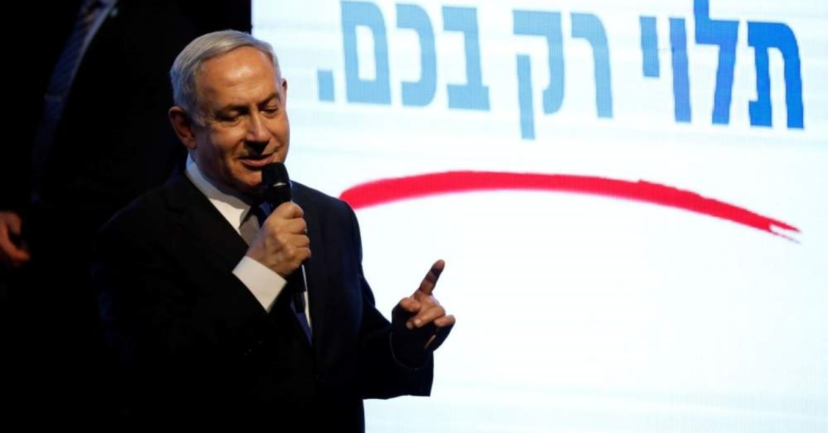 Israeli Prime Minister Benjamin Netanyahu speaks to supporters at a Likud party rally as he campaigns ahead of the upcoming elections, Tel Aviv, Feb. 18, 2020. (REUTERS Photo)