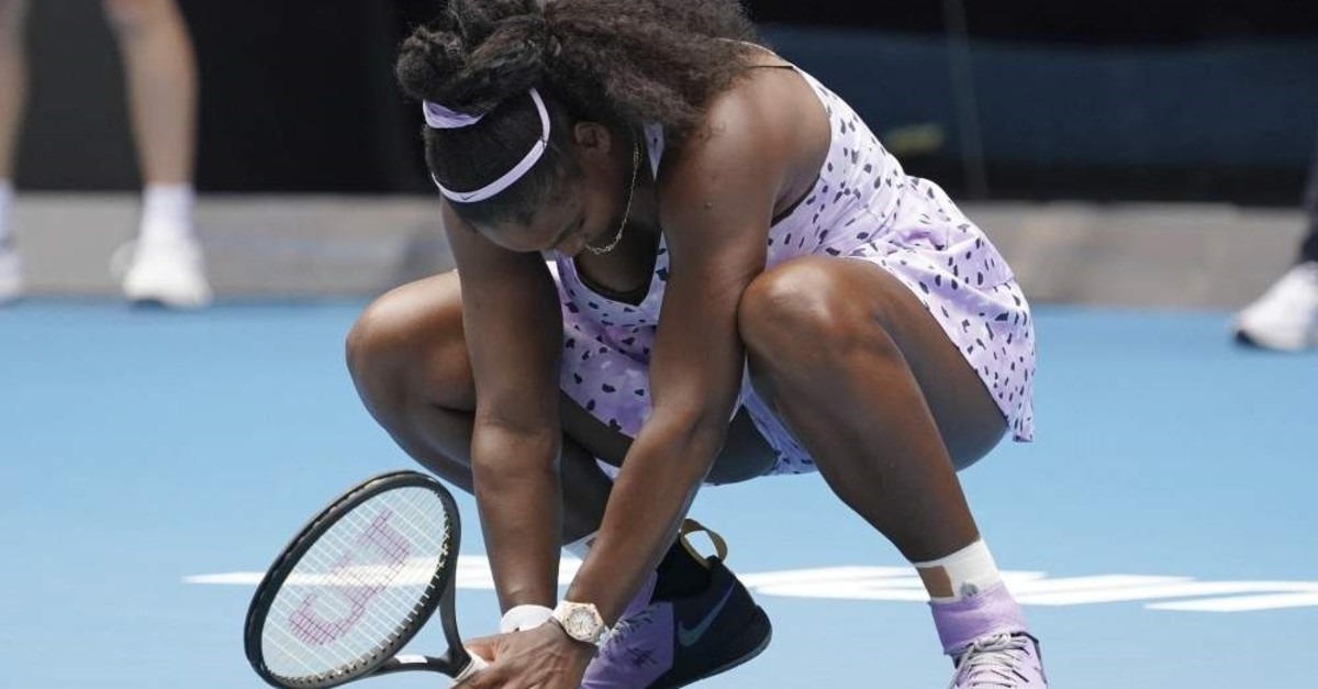 Serena Williams of the U.S. reacts as she plays against China's Wang Qiang in their third round singles match at the Australian Open tennis championship in Melbourne, Australia, Friday, Jan. 24, 2020. (AP Photo)