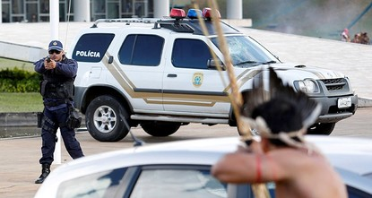 pBrazilian military police in front of Congress hurled tear gas at thousands of indigenous protesters, who responded by throwing spears and shooting arrows as a peaceful demonstration turned into...