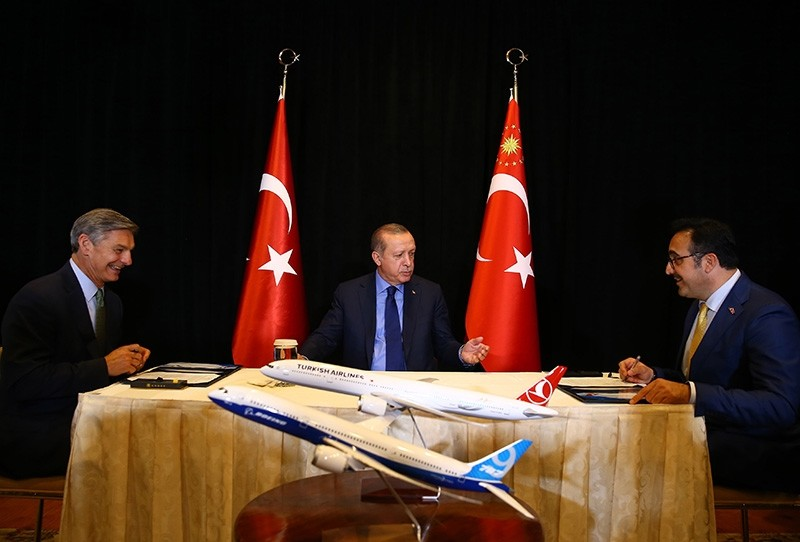 President Recep Tayyip Erdou011fan (Center) attends the signing ceremony of the 787-9 with THY Chairman of the Board u0130lker Aycu0131 (Right) and Boeing VP Raymond Conner in New York (IHA File Photo)