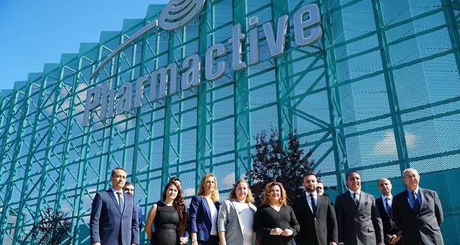 Pharmactive executives posing in front of company headquarters (DHA Photo)