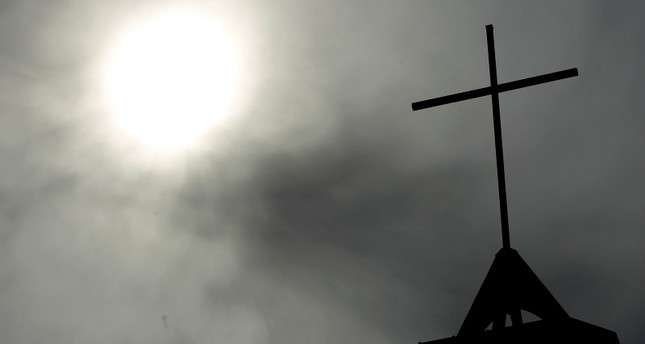 In this April 8, 2010 file photo a cross sits on top of a church in Berlin, Germany. (AP Photo)