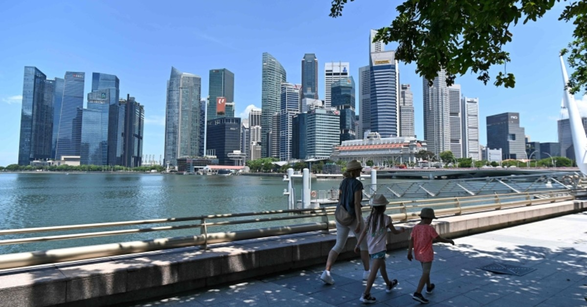 People walk near the central business district in Singapore, May 6, 2019. (AFP Photo)