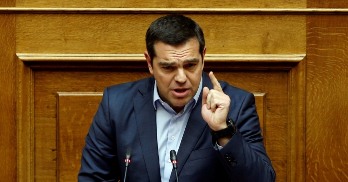 Greek Prime Minister Alexis Tsipras addresses lawmakers during a parliamentary session before a vote on German World War II reparations in Athens, Greece April 17, 2019. (Reuters Photo)