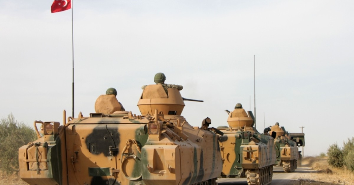 Turkish soldiers are trasported in armoured personnel carriers through the town of Tukhar, north of Syria's northern city of Manbij, on October 14, 2019 (AFP Photo)