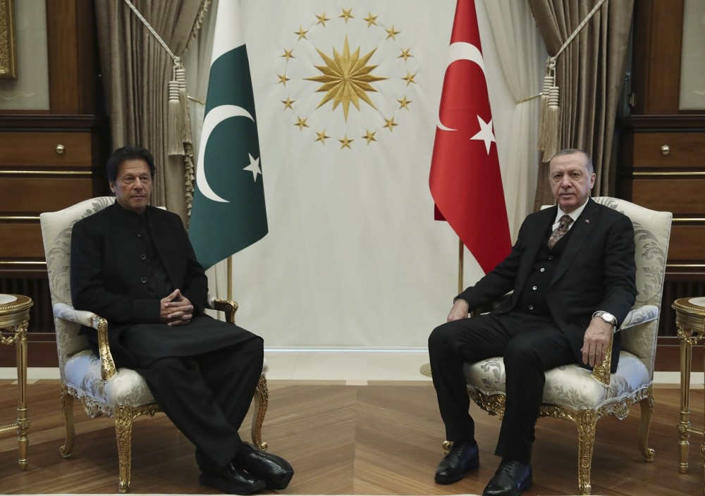 President Recep Tayyip Erdou011fan (R) and Pakistan's Prime Minister Imran Khan pose for the media before a one-to-one meeting in Ankara, Jan. 4.