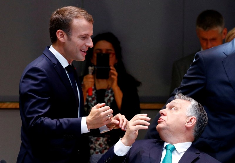 French President Emmanuel Macron talks to Hungarian Prime Minister Viktor Orban as they arrive at a European Union leaders summit in Brussels, Belgium June 29, 2018. (Reuters Photo)