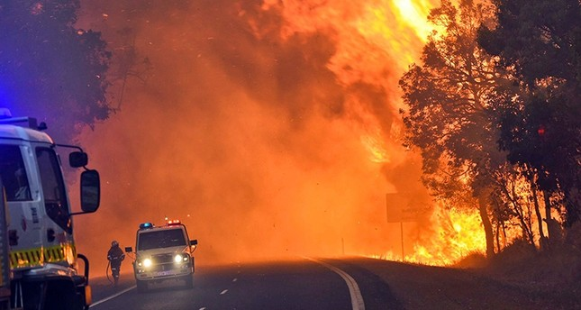 Firefighters battle a massive blaze near Yarloop in Western Australia  (AFP File Photo)