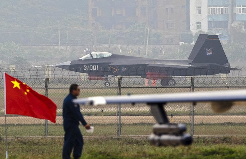 A Chinese People's Liberation Army Air Force J-31 stealth fighter lands on a runway after a flying performance at the 10th China International Aviation and Aerospace Exhibition in Zhuhai, Guangdong province, in November 2014. (Reuters Photo)