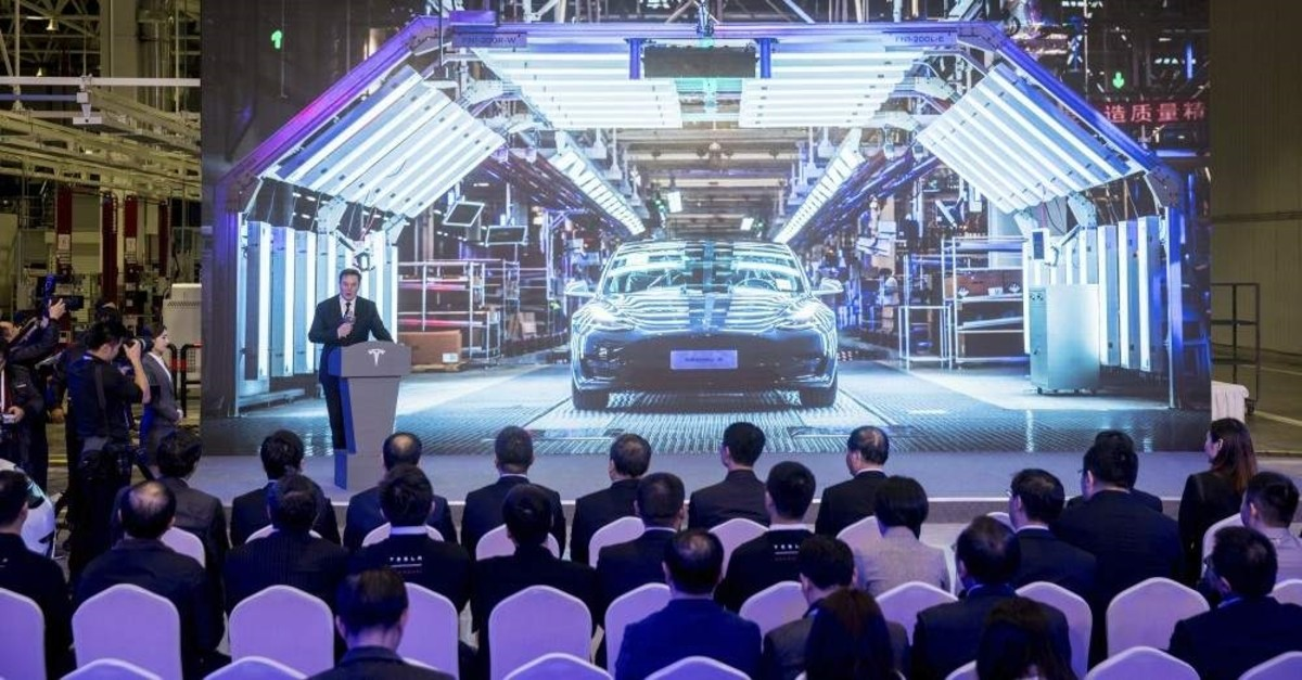 In this photo released by China's Xinhua News Agency, Tesla CEO Elon Musk speaks at a delivery ceremony for the first Tesla Model 3 cars made at Tesla's Shanghai factory in Shanghai, Tuesday, Jan. 7, 2020. (Ding Ting/Xinhua via AP)