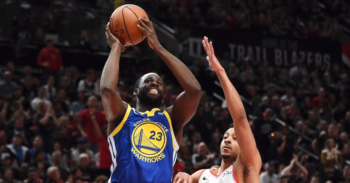 Draymond Green #23 of the Golden State Warriors shoots the ball against CJ McCollum #3 of the Portland Trail Blazers in game three of the NBA Western Conference Finals at Moda Center on May 18, 2019 in Portland, Oregon, May 18, 2019.