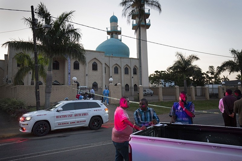 Police officers stand outside the Imam Hussain Mosque where three members of the clergy where attacked with knives, hours earlier, in Durban, South Africa, May 10, 2018. (EPA Photo)