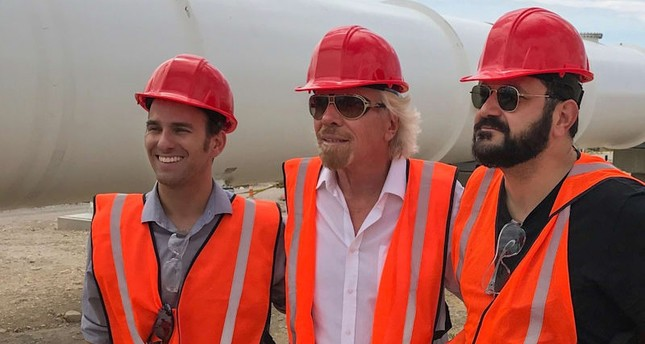 Richard Branson (C) with the co-founders, Executive Chairman Shervin Pishevar and President of Engineering Josh Giegel. (Photo courtesy of Virgin Group)