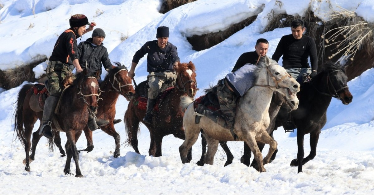 Kyrgyz riders practice in a village square in Van province, Feb. 27, 2019.