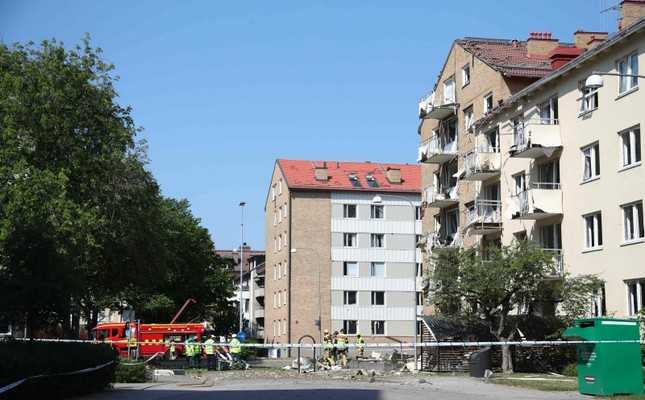 Rescue personnel work outside a block of flats that were hit by an explosion Friday morning, June 7, 2019 in Linkoping, southern Sweden. Photo by Jeppe GUSTAFSSON / TT News Agency / AFP