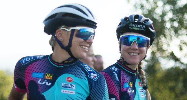 Tetiana Kalachova (L) and Christine Michelet (R), members of the female team of amateur cyclists completing the Tour de France route to raise awareness for women's cycling and promote the return of the women's Tour, in Carcassonne, France, July 23
