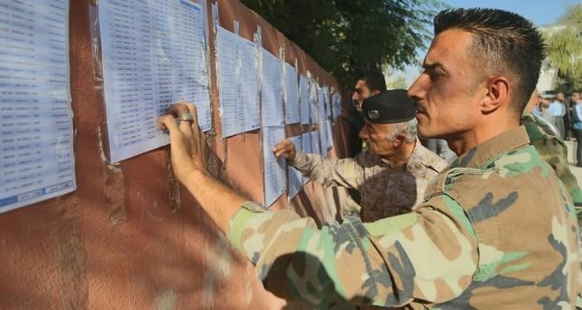 رجال الأمن يدلون بأصواتهم في الانتخابات البرلمانية بإقليم شمال العراق