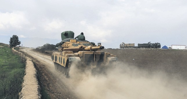 A Turkish military tank crosses the Turkish-Syrian border to advance over the Afrin region to participate the counterterrorism offensive against YPG elements in northern Syria.