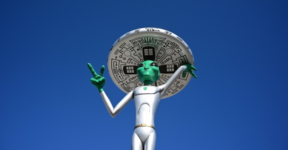 In this file photo taken on March 4, 2019, an Alien sculpture lines the side of the road in the town of Baker, California, known as the 'Gateway to Area 51.' (AFP Photo)