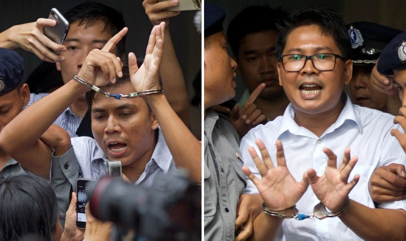 Reuters journalists Kyaw Soe Oo, left, and Wa Lone, are handcuffed as they are escorted by police out of the court Monday, Sept. 3, 2018, in Yangon, Myanmar. (AP Photo)