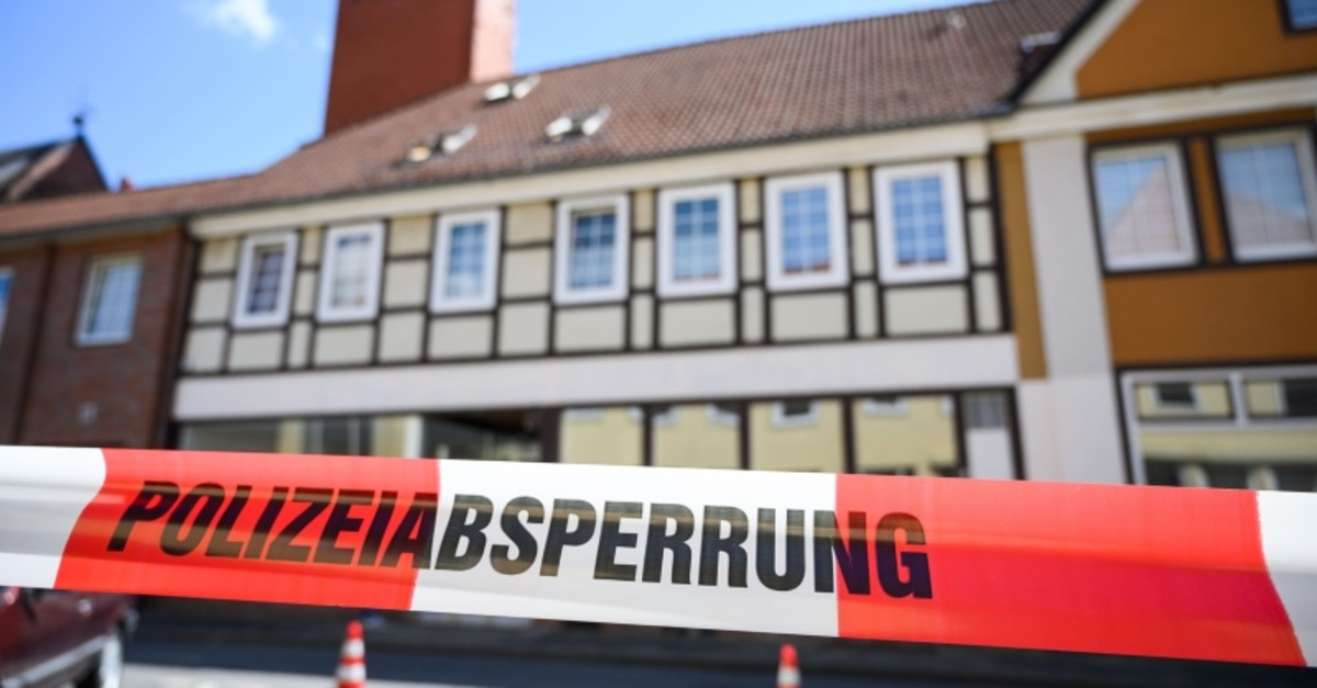 A house is cordoned off in Wittingen, northern Germany, where two bodies were found on May 13, 2019 during investigations into the deaths of three people discovered in a Bavarian hotel room and killed by crossbow bolts. (AFP Photo)