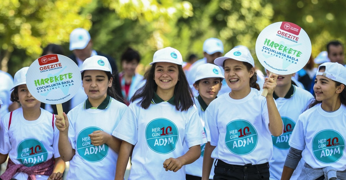 Children walk in the capital Ankara as part of nationwide events, Oct. 3, 2019.