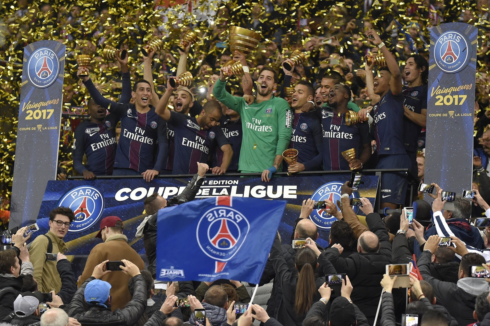 Paris Saint Germain players celebrate their win with the trophy after the the French Coupe de la Ligue final soccer match. (EPA Photo)